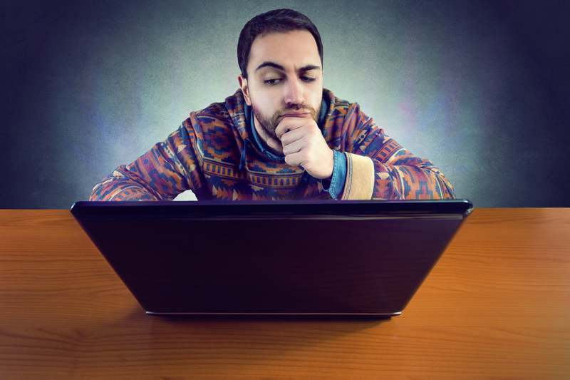 Man watching sketchy content