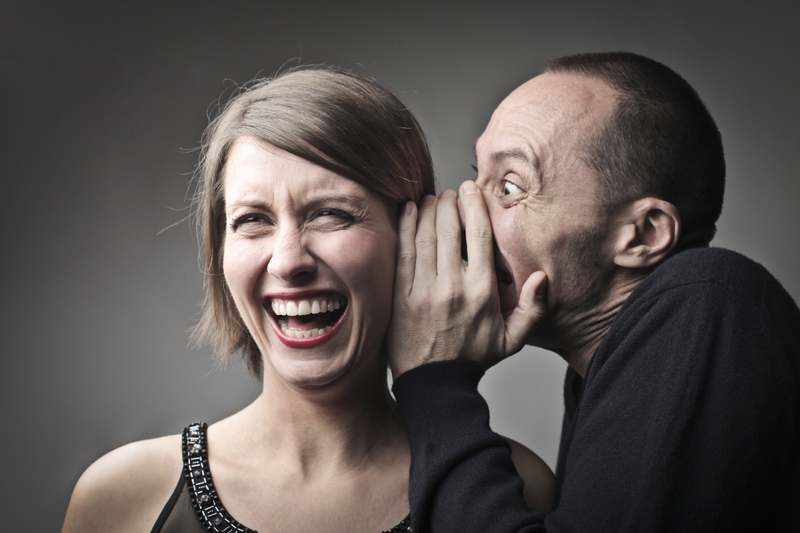Man telling woman joke