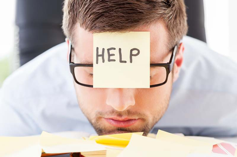 man with help sticky note on his forehead