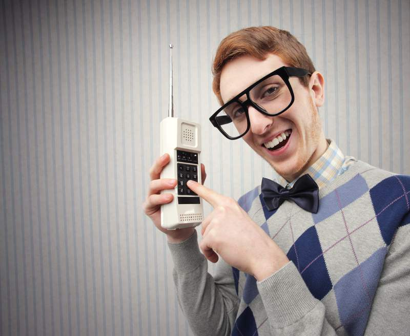 Nerd with old phone