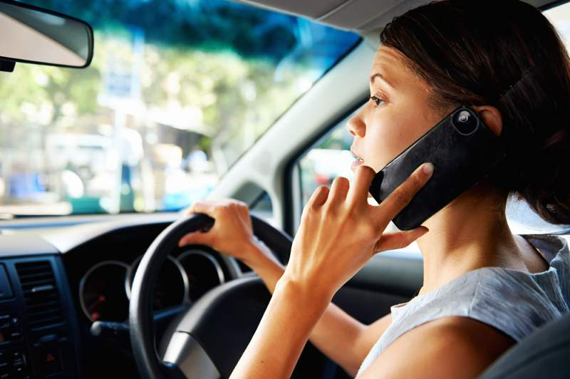 driver talking on her phone