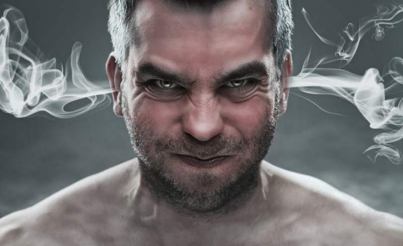 man with smoke coming out of his ears