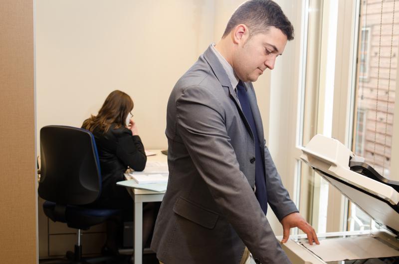 Businessman photocopying