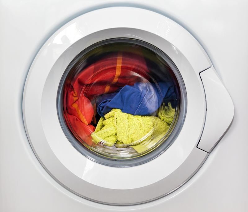 Washing machine with clothes inside