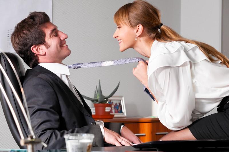 Businesswoman & man flirting